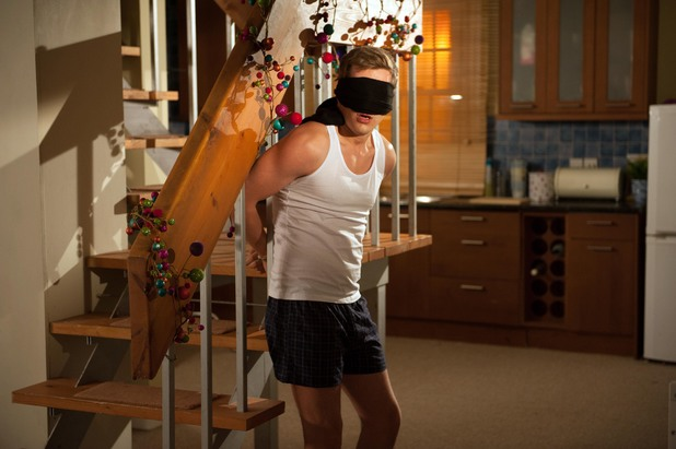 Hollyoaks, John Paul tied to staircase, Thu 19 Dec