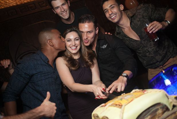 Mahiki Dubai 2nd Anniversary Party, Dubai, UAE - 18 Dec 2013 Kelly Brook cutting the cake with Abercrombie and Fitch models