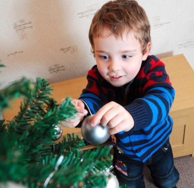 Kyle has been able to help decorate the house for Christmas for the first time