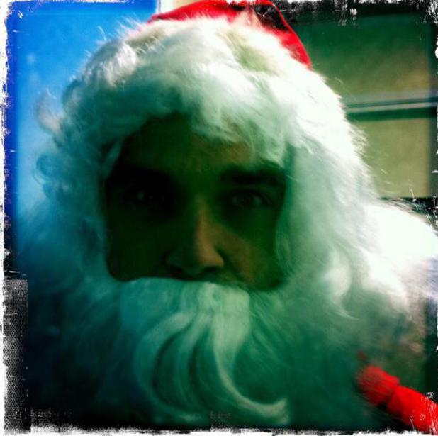 Robbie Williams dresses up as Santa Claus to kick off ITV's Text Santa fundraising appeal.