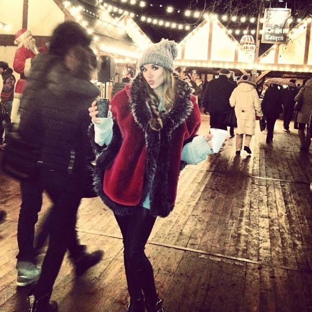 Jodi Albert poses in faux fur cape at WInter Wonderland - 20 December 2013