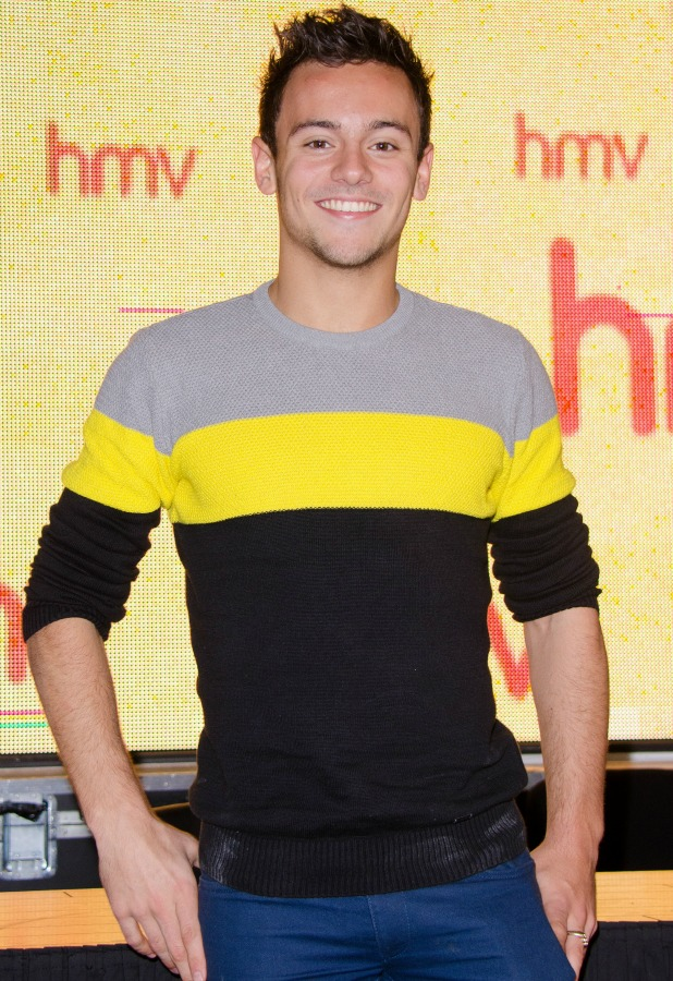 Tom Daley signs copies of his official 2014 calendar at HMV Oxford Circus, 11 October 2013