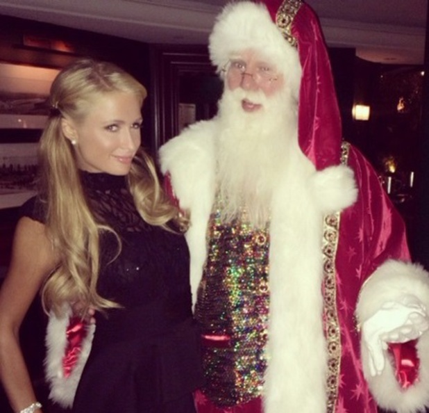 Paris Hilton on Christmas Eve meeting Santa, 24 December 2013