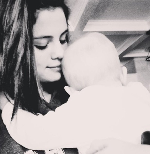 Selena Gomez says she's happier than ever as she posts picture of herself and sister Gracie, 22 December 2013