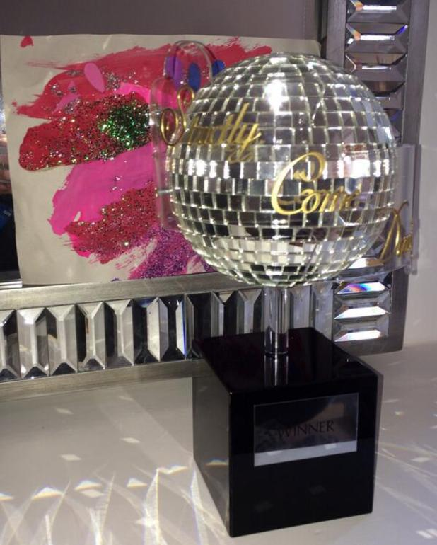 Abbey Clancy places Glitter Ball trophy on mantlepiece after Strictly Come Dancing win - 23 December 2013