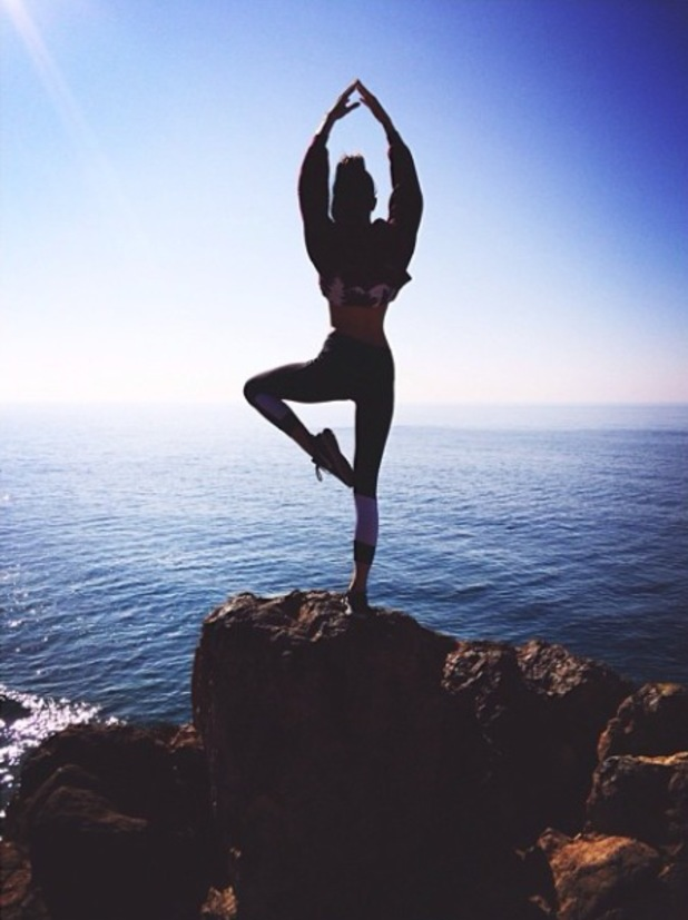 Kendall Jenner does the 'tree' yoga move on cliff in Los Angeles - 23 December 2013