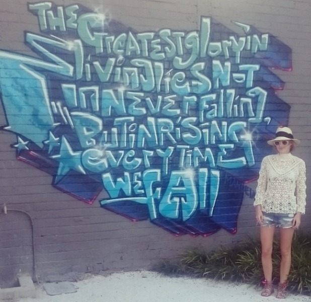 Rosie Fortescue admires the graffiti on holiday in Cape Town, December 2014.