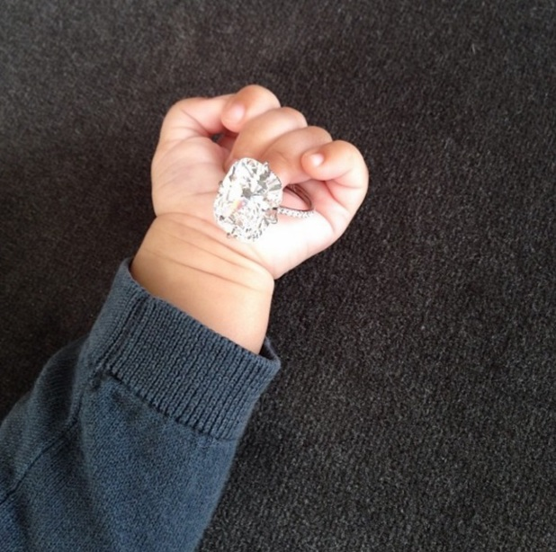 Kim Kardashian ends 2013 with photo of baby North and her engagement ring, 31 December 2013
