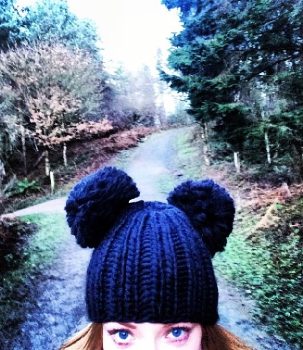 Nicola Roberts is pictured wearing a pompom hat during a country walk - 2 January 2013