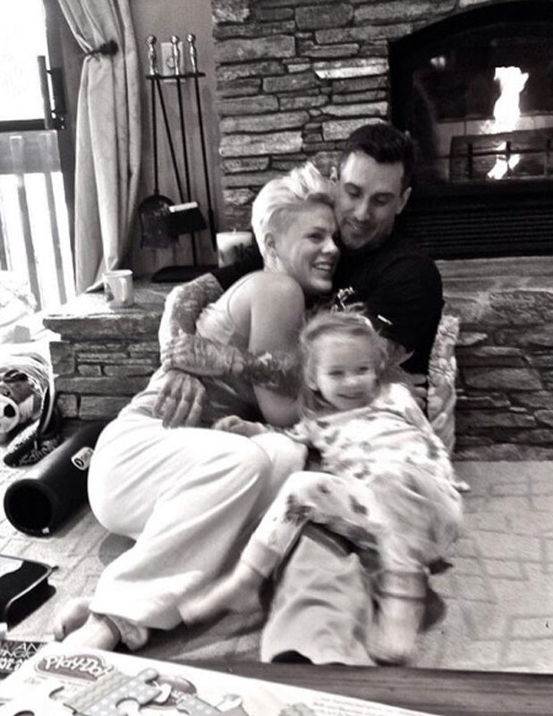 Pink and Carey Hart celebrate New Year's Eve with daughter Willow, 31 December 2013