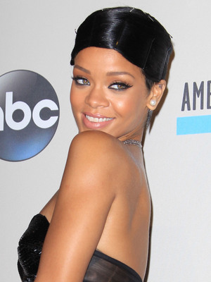 Rihanna on the red carpet at the American Music Awards in the Nokia Theatre, Los Angeles, on 24 November 2013.
