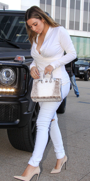 Kim Kardashian dressed in all white as she departs an office in Century City, Los Angeles - 10 January 2013