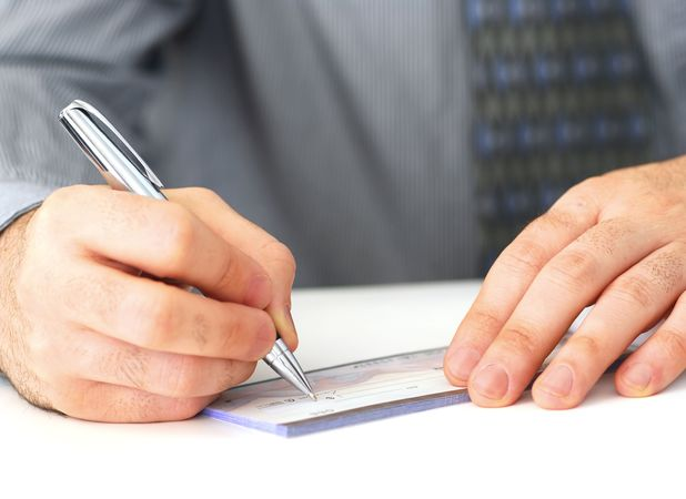Man writing cheque