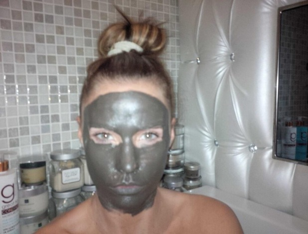 Katie Price treats herself to a mud face mask - 4 January 2014