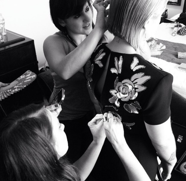 Kelly Osbourne gets zipped into her dress for the Golden Globes, 12 January 2014