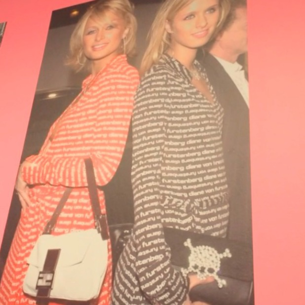 """A picture of Paris and Nicky Hilton at the opening of DVF's """"Journey of a Dress"""" exhibition in Los Angeles, 10 January 2014"""