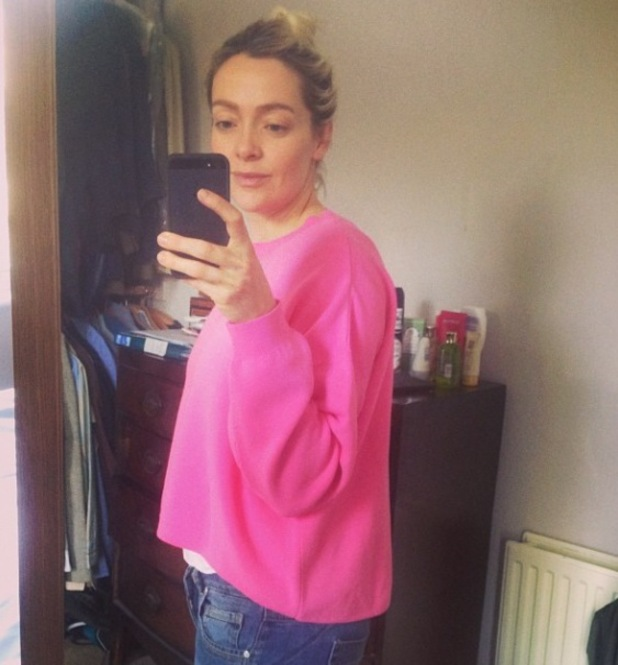 Cherry Healey shows off her post-baby body in a bright pink sweatshirt - 9 January 2014