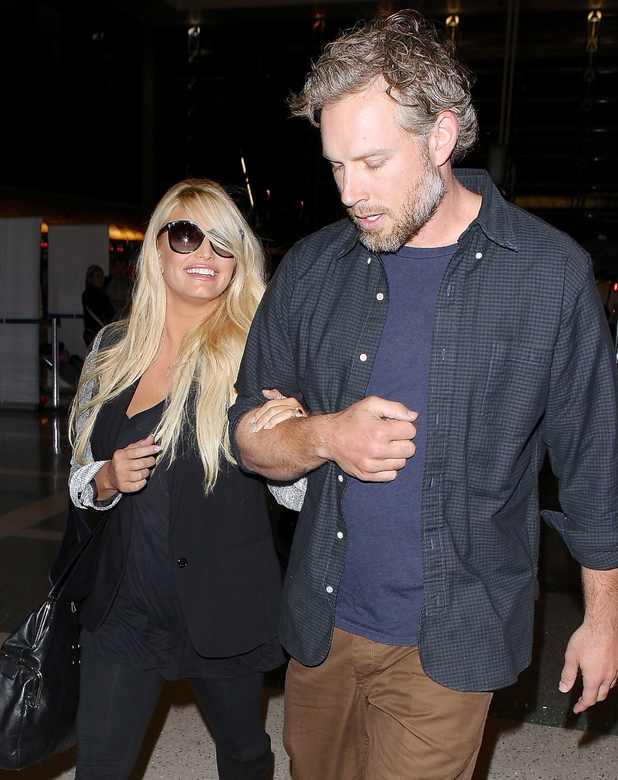 Jessica Simpson and fiancé Eric Johnson arrive at LAX airport to catch a departing flight 10/14/2013. Los Angeles, United States