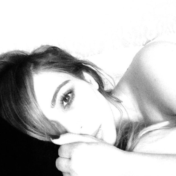 Kim Kardashian shares a selfie from bed, 7 January 2013