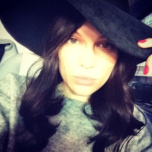 Jessie J shows off longer hair extensions as she heads off to Los Angeles. (13 January).