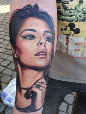 Cheryl Cole posts photo of fan's tattoo of her face. (14 January 2014).