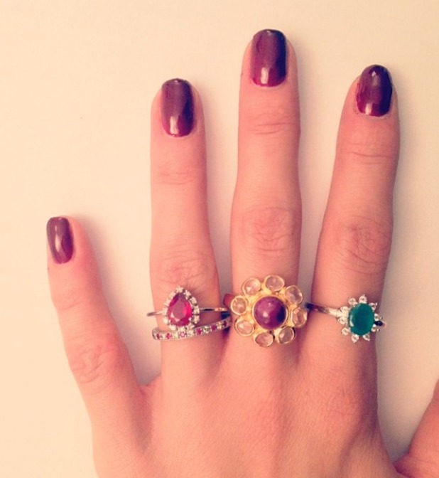 Millie Manderson (nee Mackintosh) shows off her dark red nails and fabulous rings, 18 December 2013
