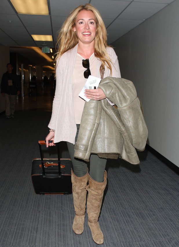 Cat Deeley leaving for a flight at Los Angeles International Airport (LAX) wearing brown suede boots, 14 January 2014