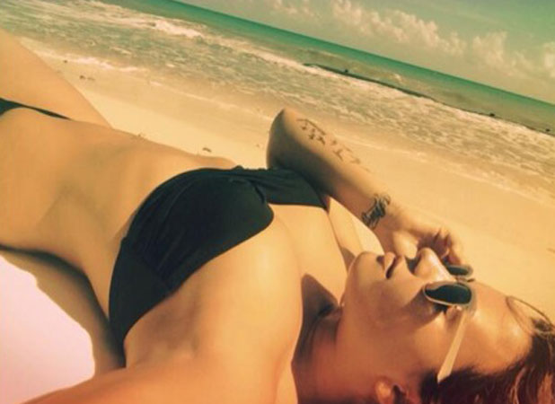 Demi Lovato tweets picture of herself in a bikini on holiday, 15 January 2014