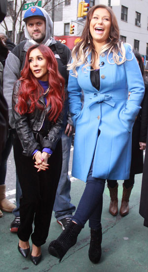 Nicole Snooki Polizzi and Jennifer JWoww Farley pictured filming a segment on Access Hollywood promoting the season end of the MTV reality show Snooki & Jwoww, 13 January 2014