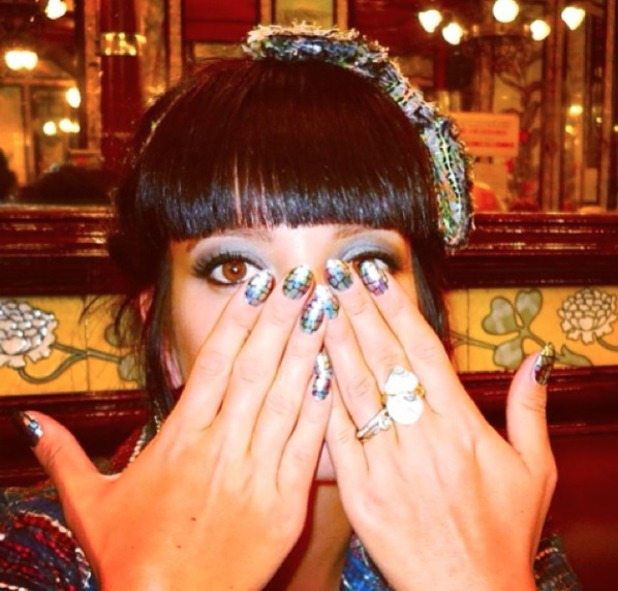 Lily Allen shows off her metallic, eel skin nails, 21 January 2014
