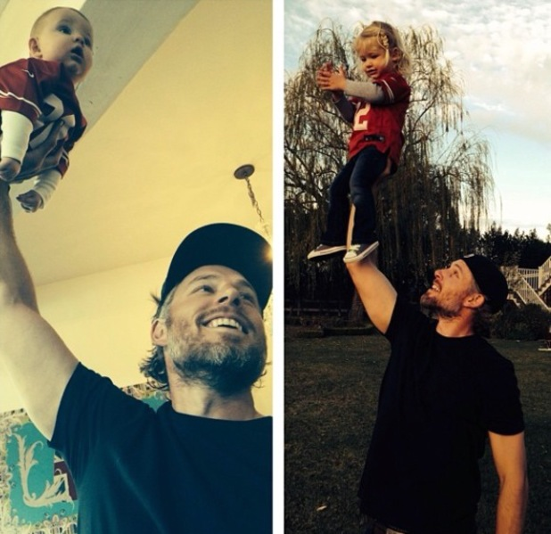 Eric Johnson lifts children Ace and Maxwell into the air for a photo - 19.1.2014