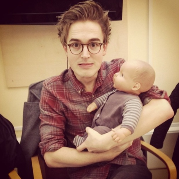 Tom Fletcher poses with doll at baby first aid class - January 2014