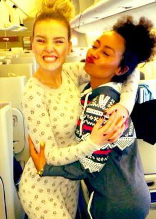 Little Mix' Perrie Edwards and Leigh-Anne Pinnock wear onesie on their flight to Japan (21 January).