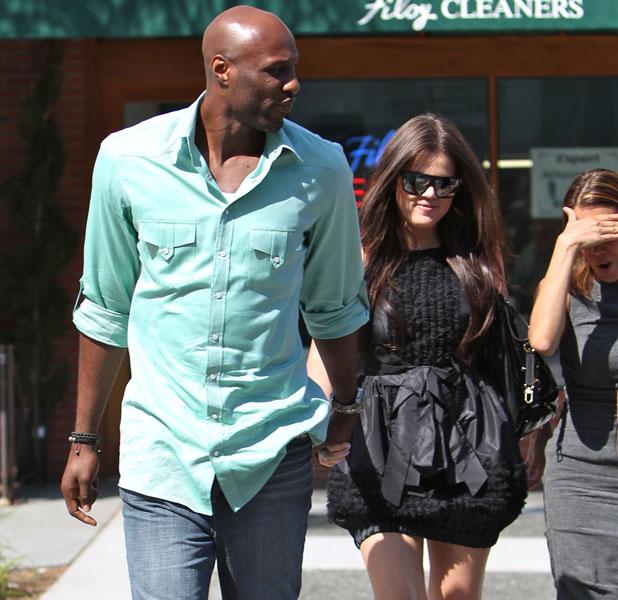 Khloe Kardashian and husband Lamar Odom leaving La Scala restaurant in Beverly Hills, June 2010