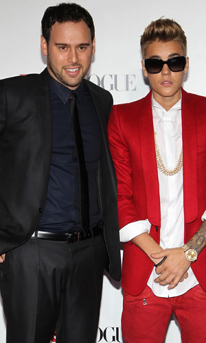 Justin Bieber and Scooter Braun at the LA premiere of Believe, January 2014