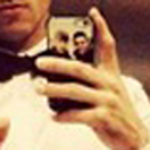 Tom Daley shows he has a picture of Dustin Lance Black on his phone cover after the National Television Awards, 22 January 2014