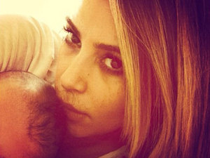 Kim Kardashian shares selfie of herself and daughter North, Instagram, 29 January 2014
