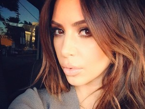 Kim Kardashian shows off her new brunette locks on Instagram, 2 February 2014