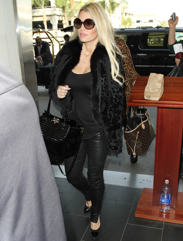 Jessica Simpson all smiles as she arrives at Los Angeles International Airport (LAX) dressed in black - 29 January 2014