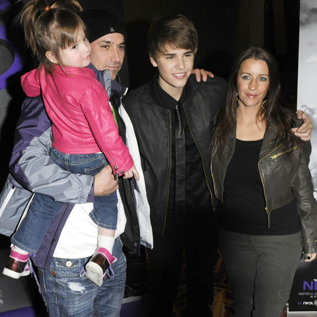Justin Bieber with his father Jeremy Bieber, mother Pattie Lynn Mallete and little sister Jazmyn Bieber, 'Never Say Never' Toronto premiere at AMC Yonge and Dundas, Canada, 2011.