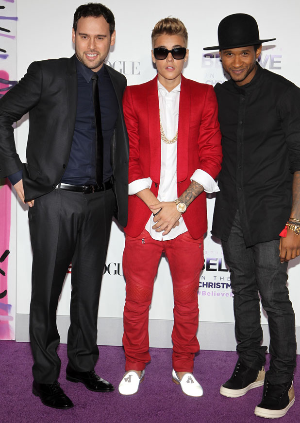 Justin Bieber accompanied by manager Scooter Braun and mentor Usher at the Believe premiere in LA, December 2013
