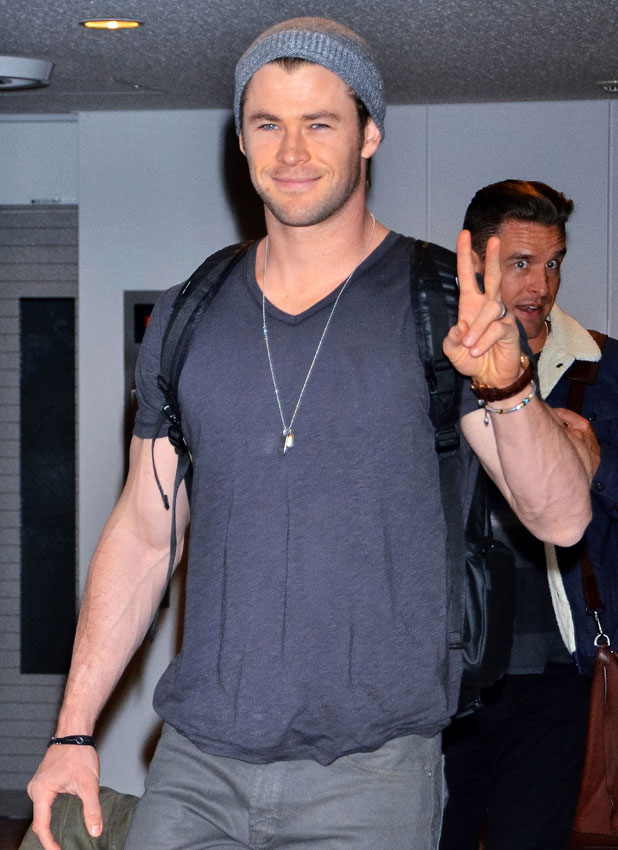 Chris Hemsworth arrives at Narita International Airport to a large group of waiting fans, 26 January 2014