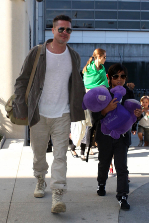 Brad Pitt and Angelina Jolie arriving at Los Angeles International Airport (LAX) with their children on a flight from Australia - 5.2.2014