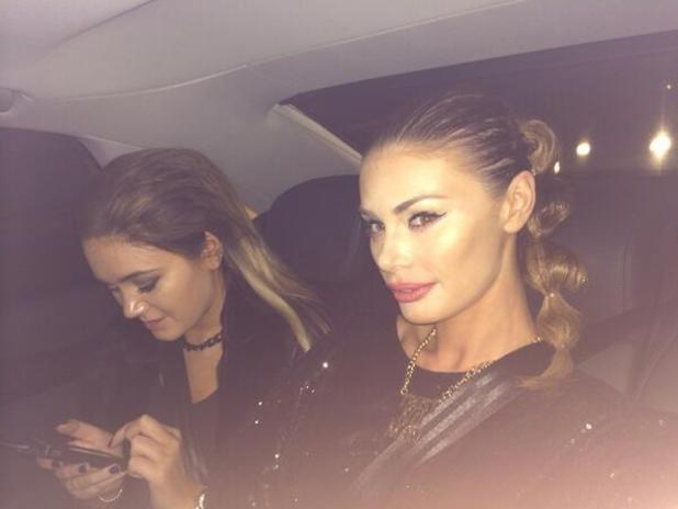 Chloe Sims rocks a bubble ponytail in the back of a taxi on the way to the Robocop film premiere, 5 February 2014
