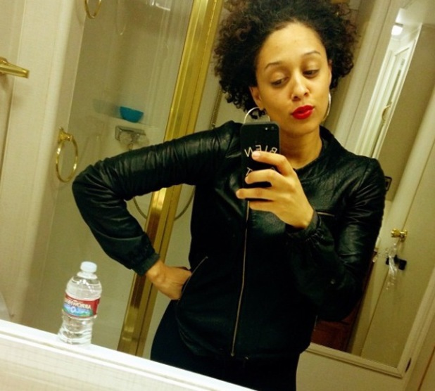 Tia Mowry embraces natural curly hair - January 2014