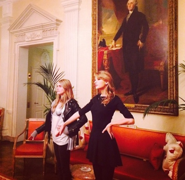 Taylor Swift and Cara Delevingne pose inside the US ambassador's house in London (6 February).