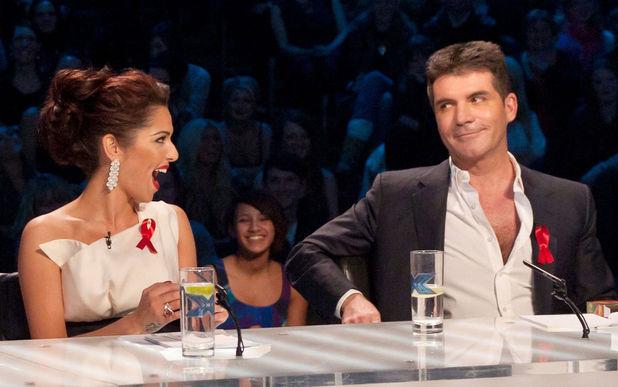 'The X Factor' Live Show, TV Programme, London, Britain - 04 Dec 2010 Judges: Cheryl Cole and Simon Cowell