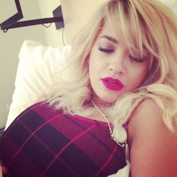 Rita Ora takes an Instagram picture after the DKNY autumn/winter 2014 show at New York Fashion Week - 9 February 2014