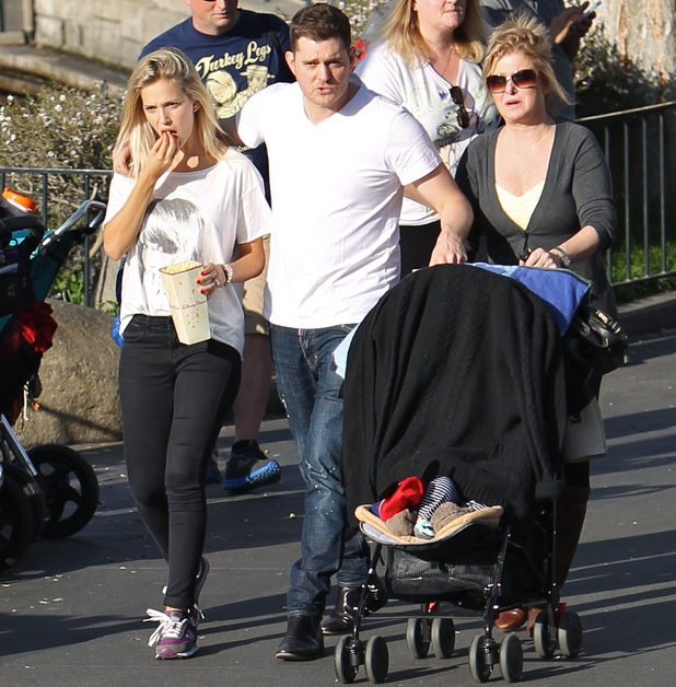 Michael Buble with his wife Luisana Lopilato and family visit Disneyland in California - 12.2.2014