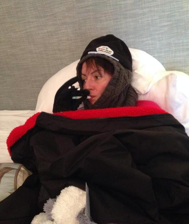Davina McCall wrapped up in blankets after Sport Relief swim at Lake Windermere - 10.2.2014